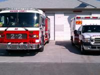 A fire truck and ambulance in front of Station 22