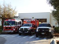 Fire truck, ambulance and fire rescue vehicle in front of Station 47