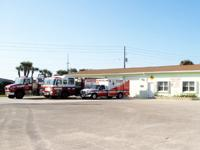 Fire truck, ambulance and fire rescue vehicle in front of Station 64