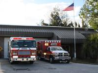 Fire truck and fire rescue vehicle in front of Station 82