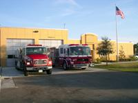 2 fire trucks in front of Station 87