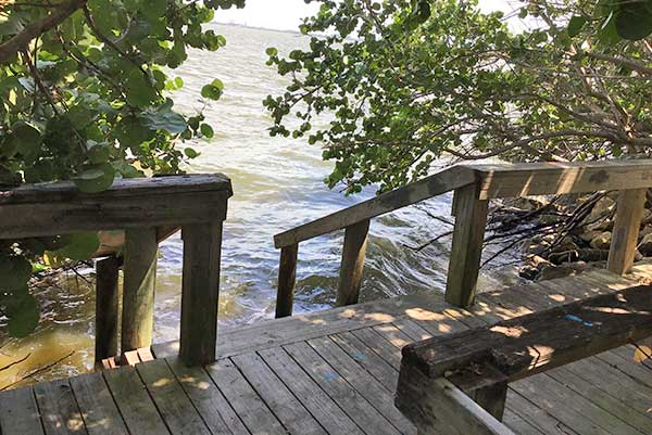Dock stairs decend into river
