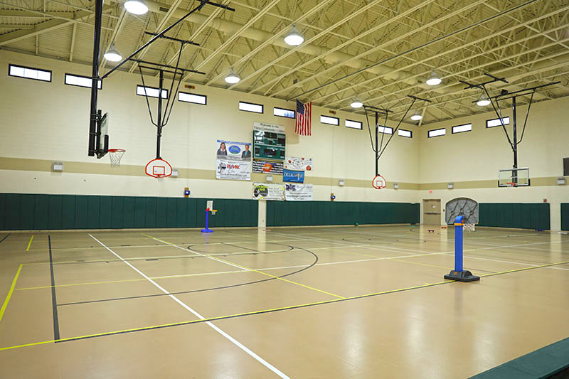 Gymnasium with multiple basketball courts