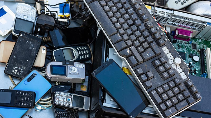 Pile of used phones and computer parts.