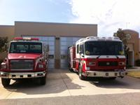 2 fire trucks in front of Station 21
