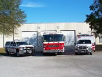 Fire truck, ambulance and fire rescue vehicle in front of Station 43