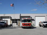 Fire truck, ambulance and fire rescue vehicle in front of Station 44