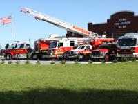 3 fire trucks, an ambulance, and fire rescue vehicle in front of Station 48