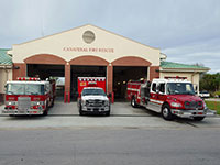 Ambulance and 2 fire trucks in front of Station 60