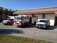 Fire truck, ambulance and fire rescue vehicle in front of Station 63
