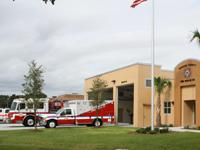 Fire truck and fire rescue vehicle in front of Station 80