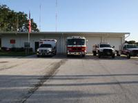 Fire truck, ambulance and fire rescue vehicle in front of Station 81