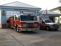 Fire truck and fire rescue vehicle in front of Station 83