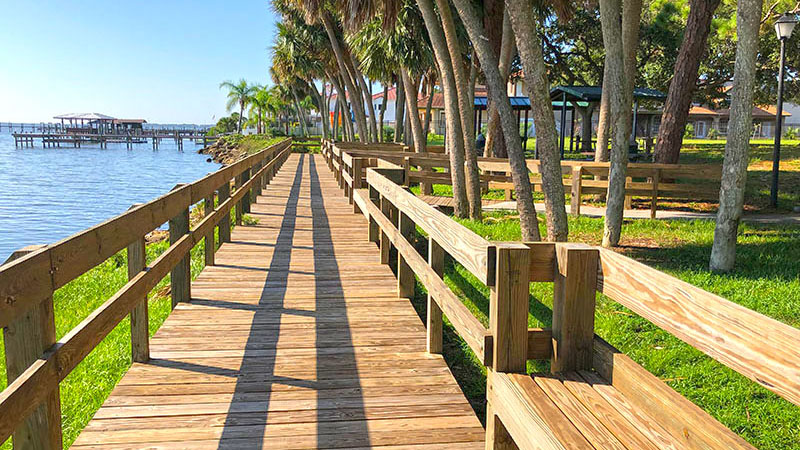 Boardwalk along water leading to pavilions