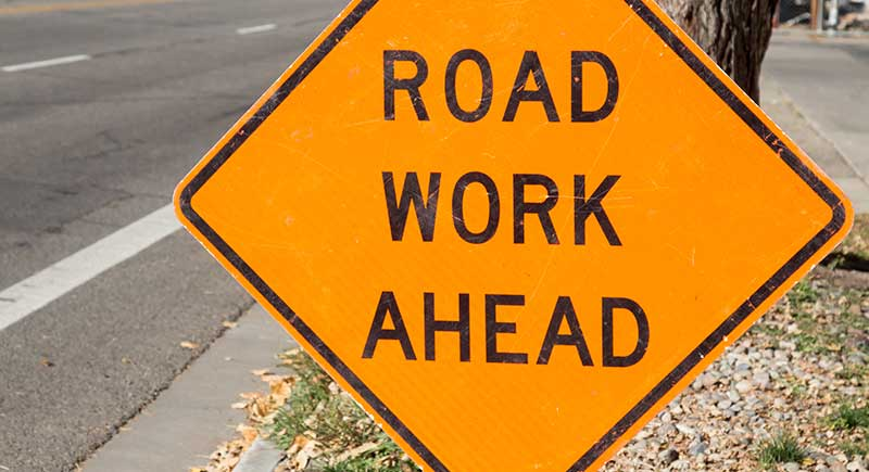 Road work ahead sign on the side of the road